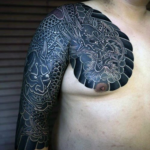 Chest and Half Sleeve Tattoo