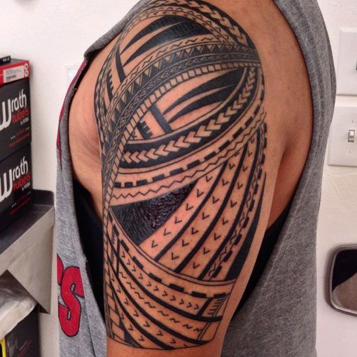 Badass Shoulder Tribal Tattoo Designs For Men