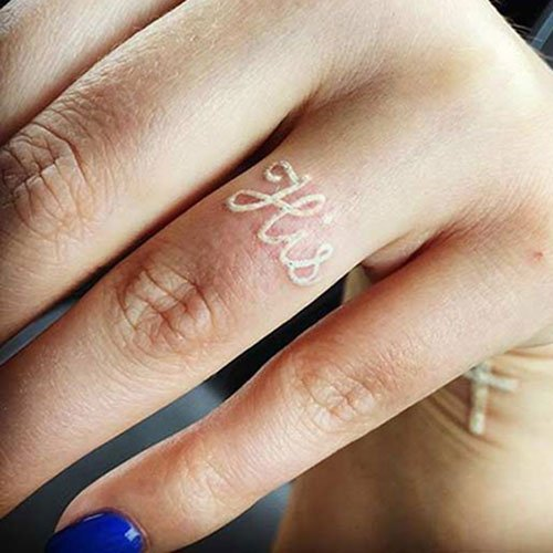 Cute Ring Finger White Ink Tattoo