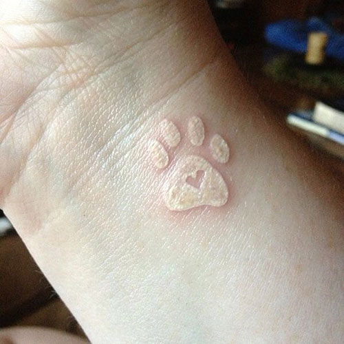 White Ink Paw Tattoo