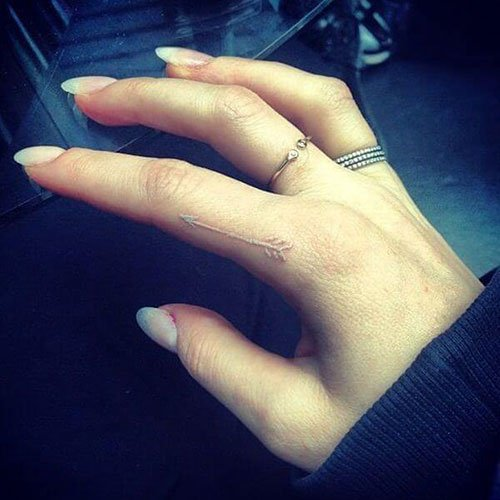 White Ink Side Finger Tattoo