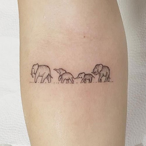 Line of Elephants Tattoo
