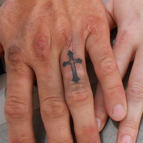 Cross Tattoo on Ring Finger