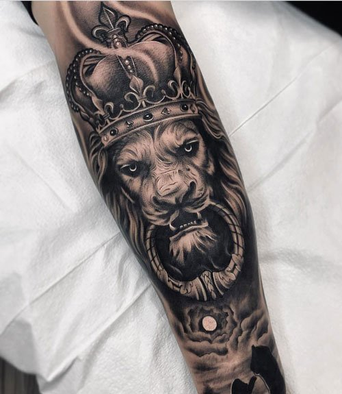 Badass Lion Forearm Tattoo with Crown