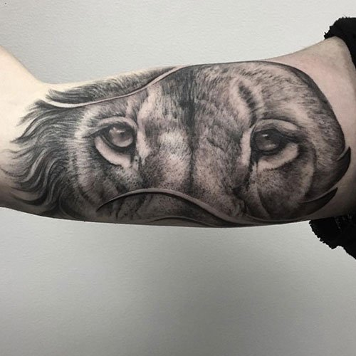 Lion Eyes Tattoo